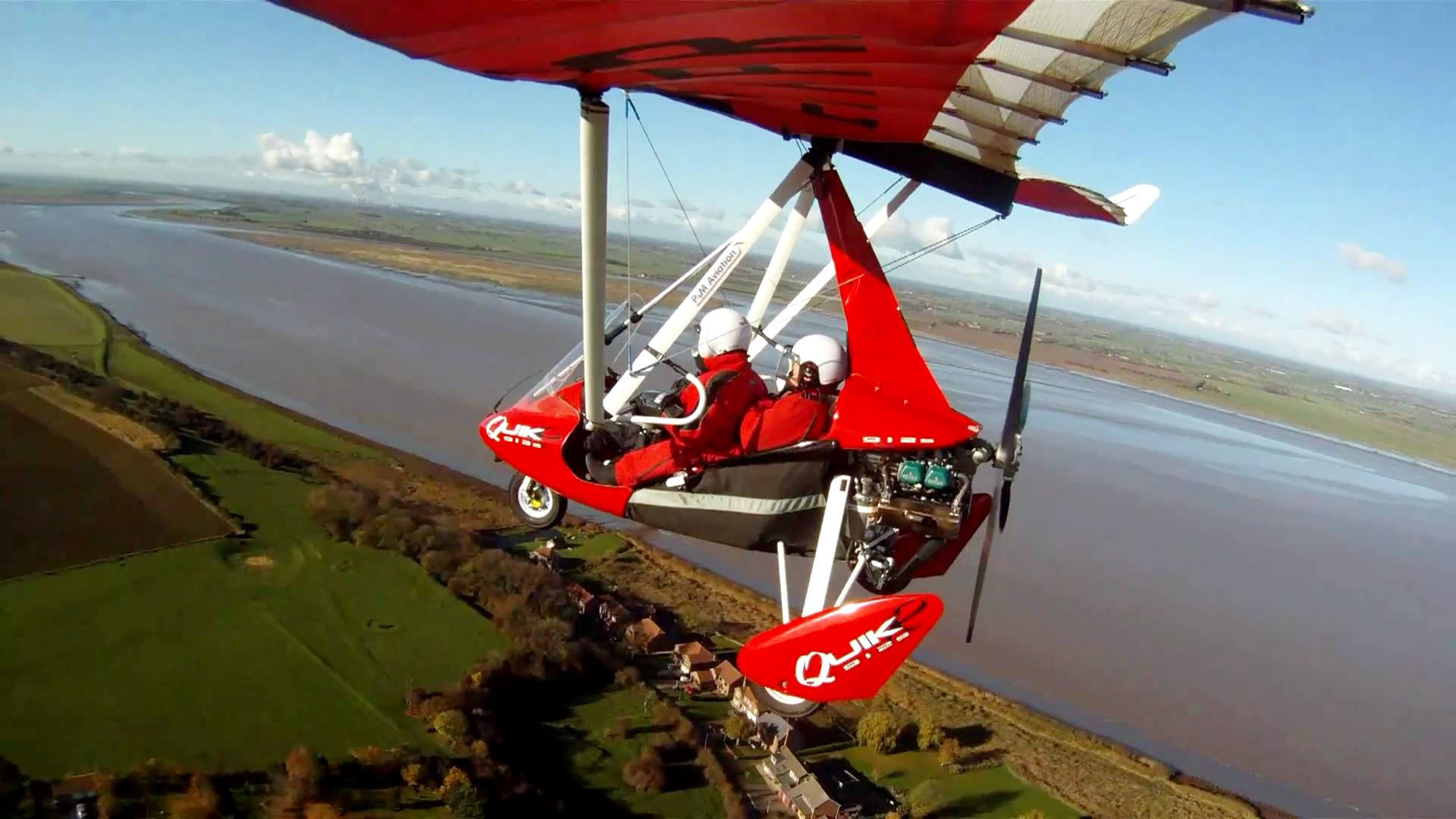 microlight flight over estuary
